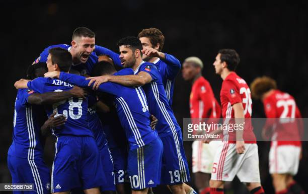 Manchester United players look dejected as N'Golo Kante of Chelsea celebrates as he scores their first goal with team mates during The Emirates FA...