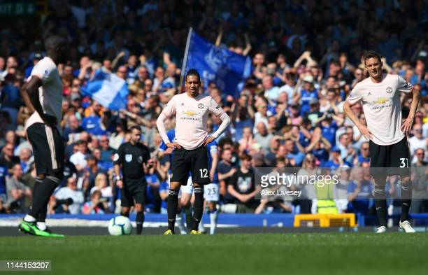Manchester United players look dejected during the Premier League match between Everton FC and Manchester United at Goodison Park on April 21 2019 in...