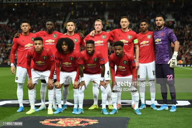 Manchester United players Manchester United's Argentinian defender Marcos Rojo Manchester United's defender Axel Tuanzebe Manchester United's...