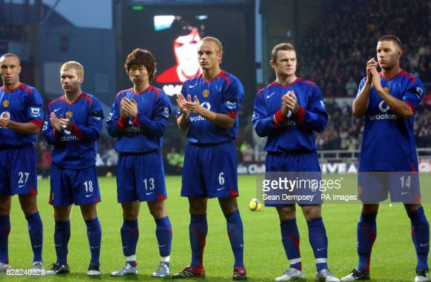 Manchester United players observe a minutes applause in respect for George Best who died on Friday during the Barclays Premiership match against West...