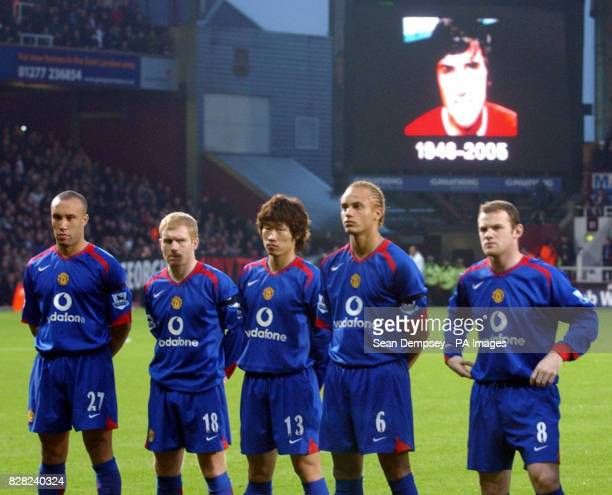 Manchester United players observe a minutes applause in respect of George Best who died on Friday during the Barclays Premiership match at Upton Park...