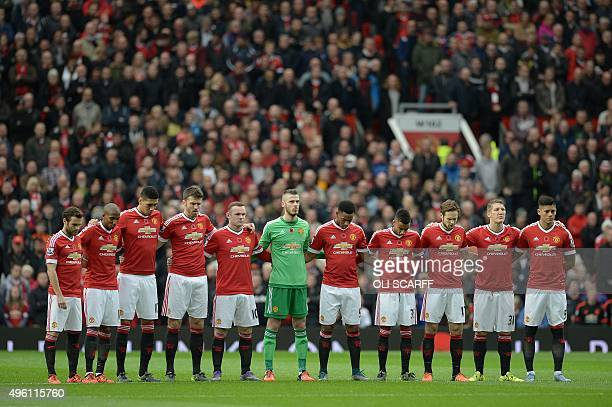 Manchester United players pause for a minute's sillence in honour of Remebance Sunday ahead of the English Premier League football match between...