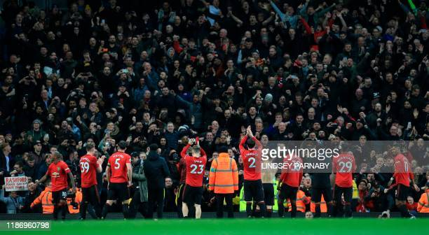 Manchester United players salute the crowd after winning the English Premier League football match between Manchester City and Manchester United at...