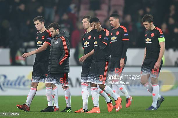 Manchester United players show their dejection after their 12 defeat in the UEFA Europa League round of 32 first leg match between FC Midtjylland and...