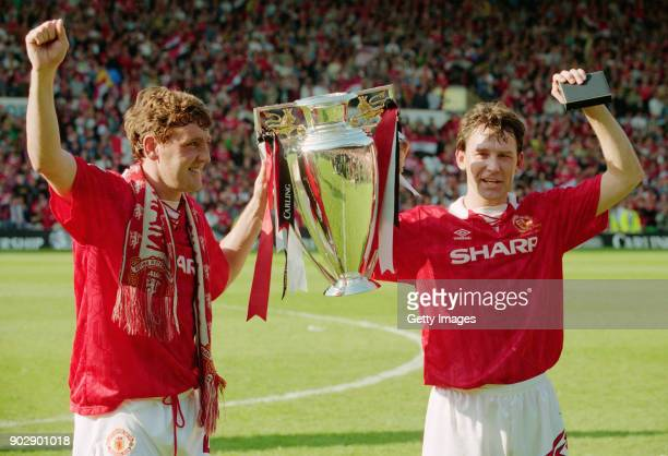 Manchester United players Steve Bruce and Bryan Robson hold aloft the inaugural Premiership Trophy after a goalless draw with Coventry City at Old...