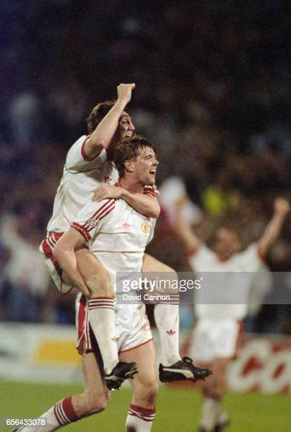 Manchester United players Steve Bruce and Gary Pallister celebrate after the 1991 European Cup Winners Cup Final between Manchester United and...