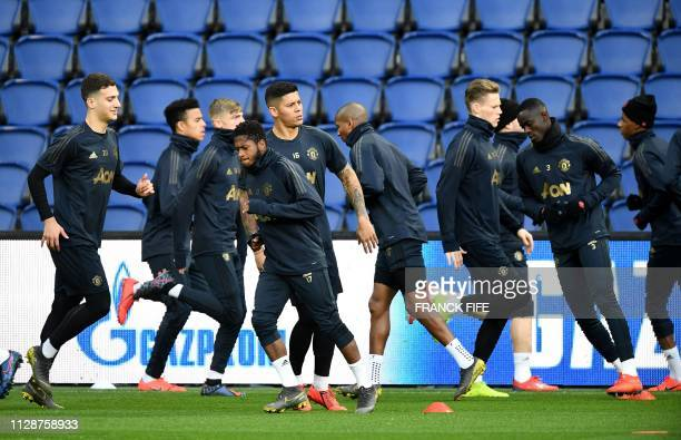 Manchester United players take part in a training session at The Parc des Princes stadium in Paris on March 5 on the eve of the UEFA Champions League...