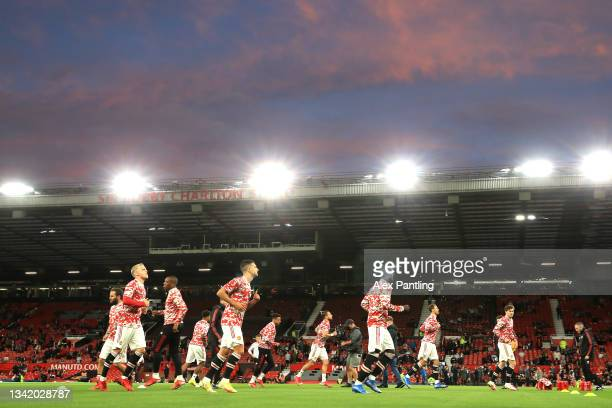Manchester United players warm up prior to the Carabao Cup Third Round match between Manchester United and West Ham United at Old Trafford on...
