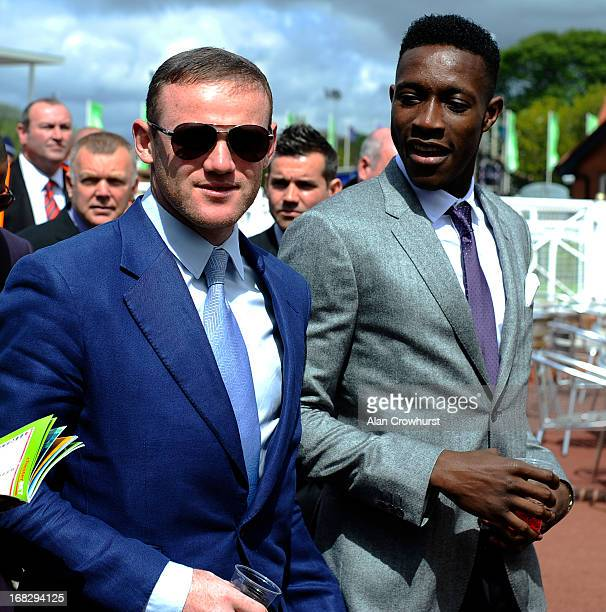 Manchester United players Wayne Rooney and Danny Welbeck arrive at Chester racecourse on May 08 2013 in Chester England