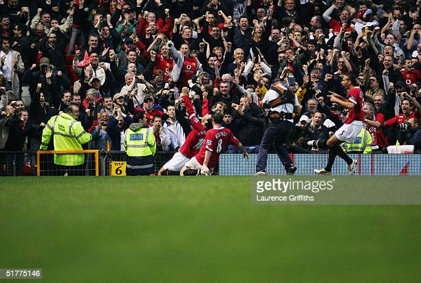 Manchester United players Wayne Rooney and Rio Ferdinand celebrate with Ruud van Nistelrooy during the FA Barclays Premiership match between...