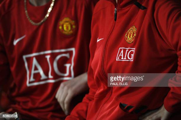 Manchester United players wear shirts with American International Group logo before their UEFA Champions League Group E football match against...