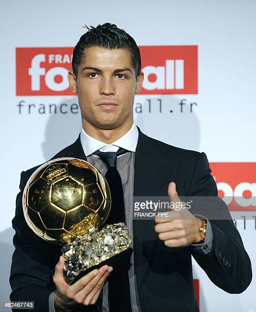 Manchester United Portuguese winger Cristiano Ronaldo holds his trophy after he received the European footballer of the year award the 'Ballon d'Or'...