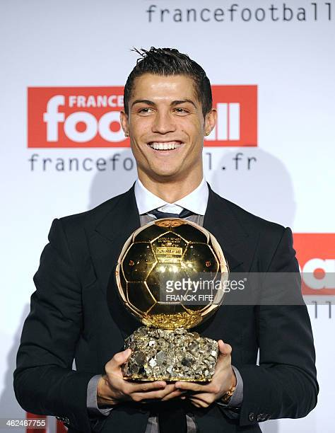 Manchester United Portuguese winger Cristiano Ronaldo holds his trophy after he received the European footballer of the year award the Ballon d'Or on...
