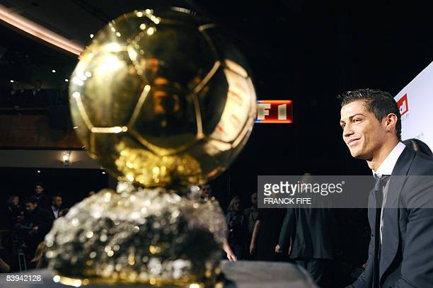 Manchester United Portuguese winger Cristiano Ronaldo poses next to his trophy after he received the European footballer of the year award the...
