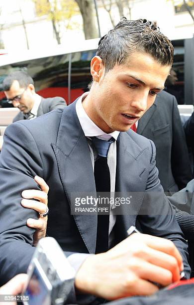 Manchester United Portuguese winger Cristiano Ronaldo signs autographs upon his arrival on December 7 2008 at an hotel in Paris for a lunch after he...