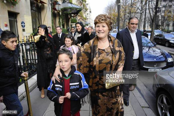 Manchester United Portuguese winger Cristiano Ronaldo's mother Maria Dolores dos Santos Aveiro poses with a supporter on December 7 2008 at an hotel...