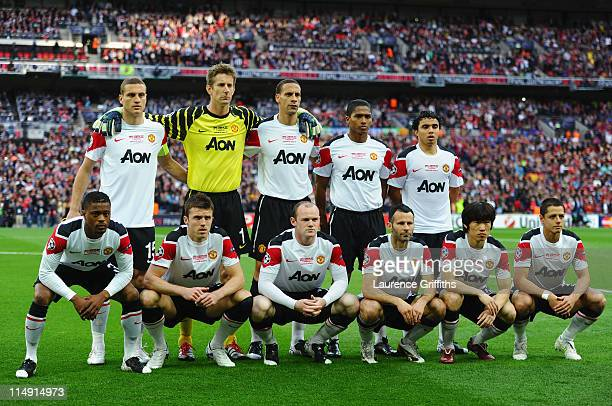 Manchester United pose for photographs ahead of the UEFA Champions League final between FC Barcelona and Manchester United FC at Wembley Stadium on...