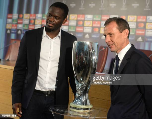 Manchester United representative Louis Saha and Emilio Butragueno pose for a photo with UEFA Super Cup trophy during press conference in Skopje...