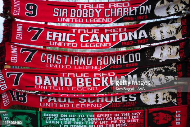 Manchester United scarfs celebrating Sir Bobby Charlton Eric Cantona Cristiano Ronaldo David Beckham and Paul Scholes prior to the Premier League...