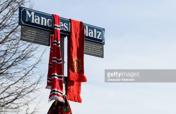 Manchester United scarfs hang from the Manchesterplatz street sign during a memorial service commemorating the Munich air disaster of February 6...