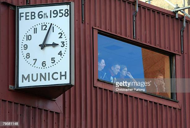 Manchester United staff look on from a window next to the Munich Clock during a memorial event for the 'Busby Babes' at Old Trafford on February 6...