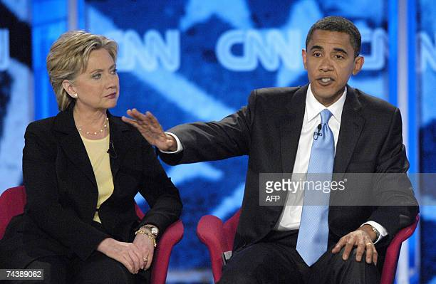 Manchester, UNITED STATES: New York Senator Hillary Rodham Clinton listens as Illinois Senator Barack Obama speaks during the Democratic Presidential...