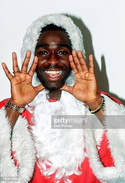 1993 Manchester United striker Andy Cole dressed up as Father Christmas in this feature photograph