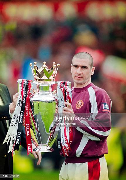 Manchester United striker Eric Cantona with the FA Carling Premiership trophy after the match against West Ham United at Old Trafford on May 11 1997...
