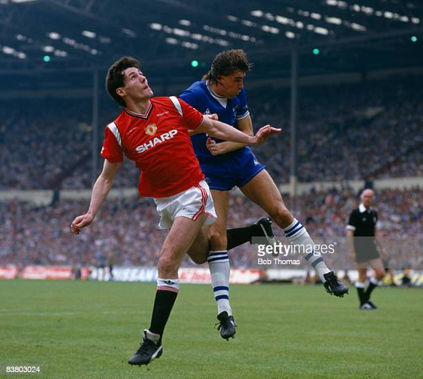 Manchester United striker Frank Stapleton clashes with Everton defender Pat Van Den Hauwe during the FA Cup Final at Wembley Stadium 18th May 1985...