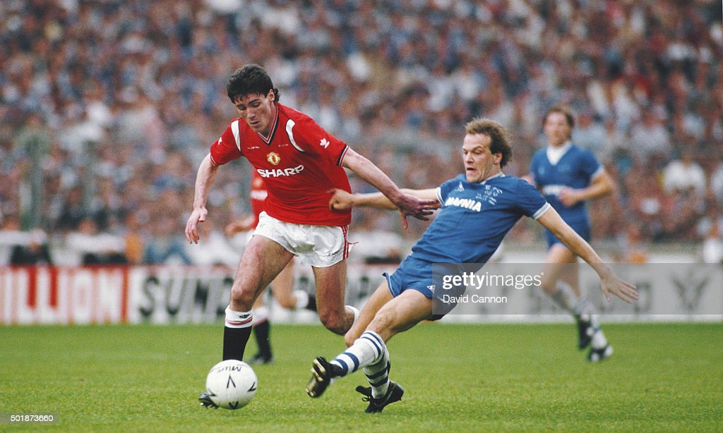 Manchester United striker Frank Stapleton (l) holds off a challenge from Everton forward Andy Gray during the 1985 FA Cup Final between Manchester United and Everton at Wembley Stadium on May 18, 1985 in London, England.