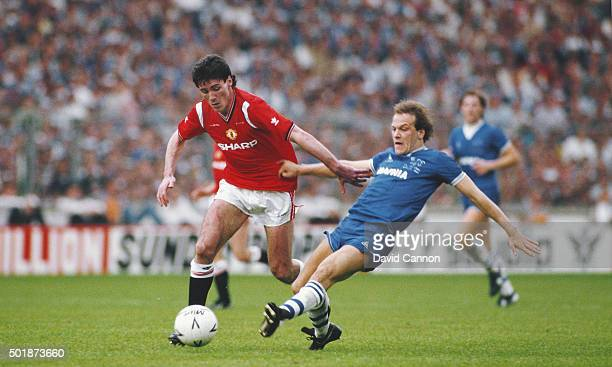Manchester United striker Frank Stapleton holds off a challenge from Everton forward Andy Gray during the 1985 FA Cup Final between Manchester United...