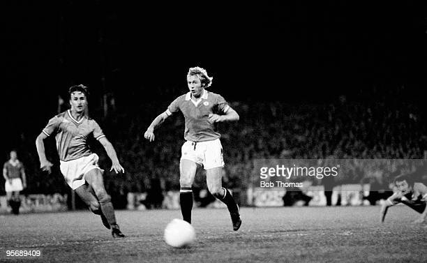 Manchester United striker Jimmy Greenhoff evades a St Etienne defender during the European Cup Winners Cup 1st round 2nd leg match played at Home...