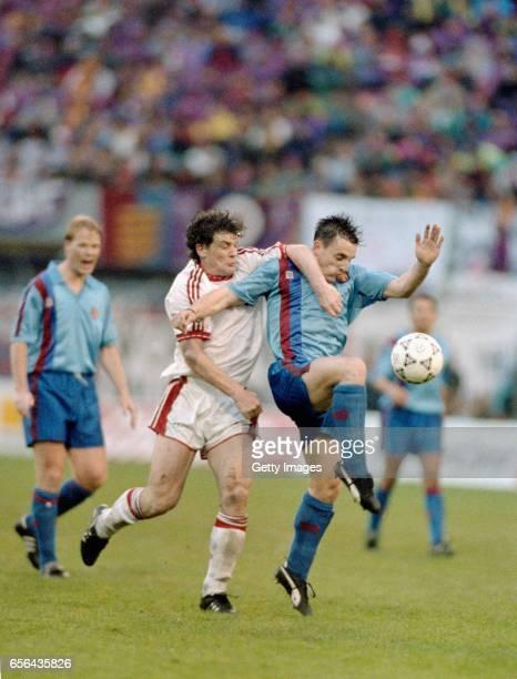 Manchester United striker Mark Hughes challenges Albert Ferrer of Barcelona during the 1991 UEFA European Cup Winners Cup Final between Manchester...