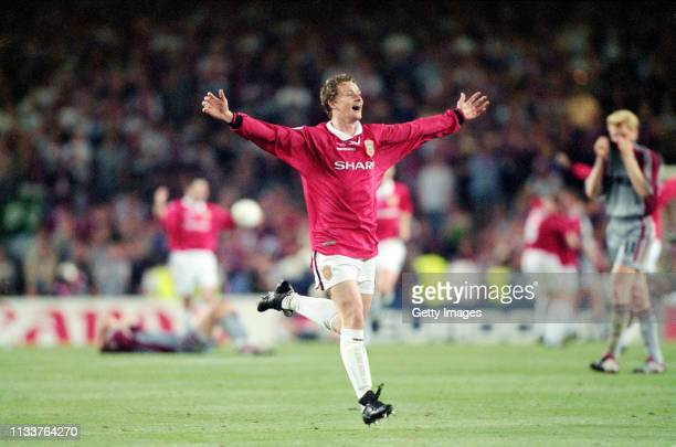 Manchester United striker Ole Gunnar Solskjaer celebrates at the end of the 1999 UEFA Champions League Final against Bayern Munich at the Camp Nou on...