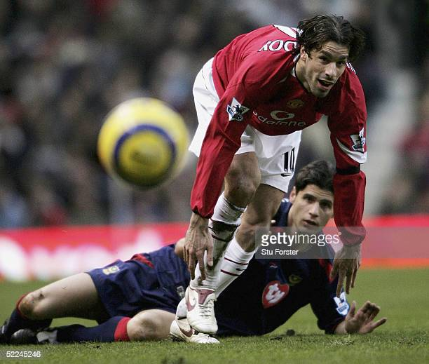 Manchester United striker Ruud Van Nistelrooy beats Dejan Stefanovic to the ball during the Barclays Premiership match between Manchester United and...