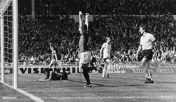 Manchester United striker Stuart Pearson far left has scored the 1st goal in their 21 victory over Liverpool in the FA Cup Final played ay Wembley on...