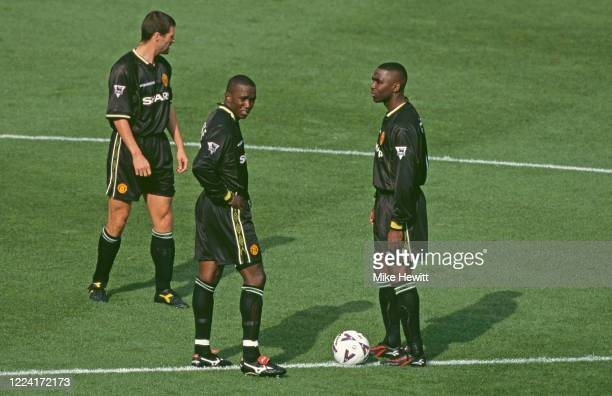 Manchester United strikers Dwight Yorke and Andrew Cole clad in their all black Umbro away kit prepare to kick off the Premier League game watched by...