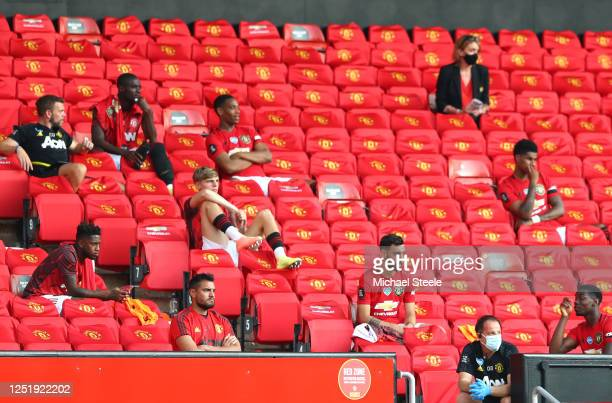 Manchester United substitute players are seen sitting in the stands during the Premier League match between Manchester United and Sheffield United at...
