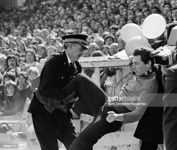 Football 24th April 1976 Filbert Street Leicester Leicester City v Manchester United A Manchester United fan is ejected by Police from the stands as...