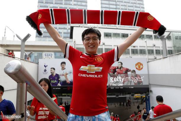 Manchester United supporter poses for photographs outside the stadium prior to the International Champions Cup match between Tottenham Hotspur and...