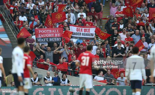 Manchester United supporters celebrate during the FA Cup semi final between Manchester United and Tottenham Hotspur at Wembley Stadium on April 21...