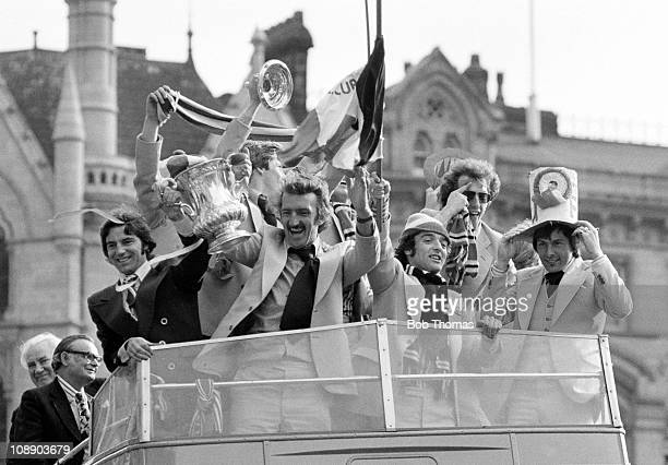 Manchester United team and officials tour the city with the FA Cup on 22nd May 1977 At the front of the bus left to right Martin Buchan Alex Stepney...