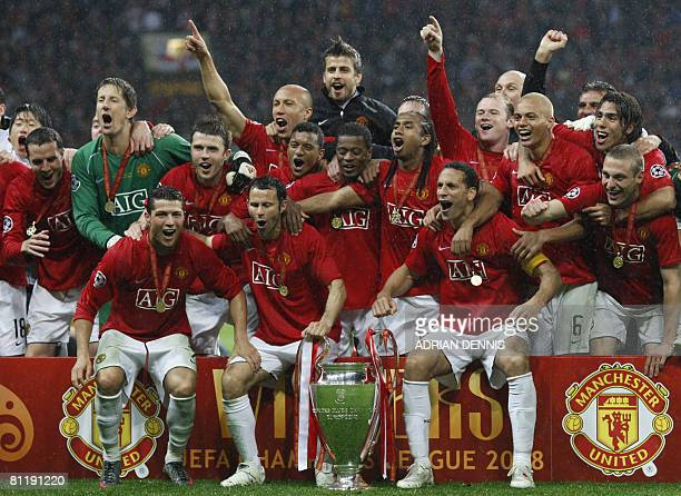 Manchester United team celebrate the trophy after beating Chelsea in the final of the UEFA Champions League football match at the Luzhniki stadium in...