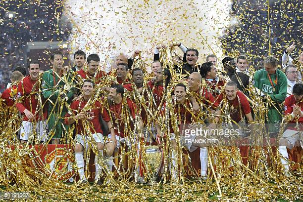 Manchester United team celebrate with the trophy after beating Chelsea in the final of the UEFA Champions League football match at the Luzhniki...