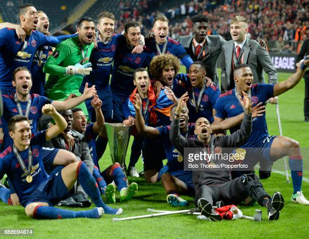 Manchester United team celebrate with the trophy after the UEFA Europa League final between Ajax and Manchester United at the Friends Arena on May...