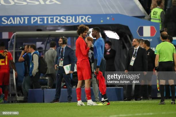 Manchester United teammates Marouane Fellaini of Belgium and Paul Pogba of France at full time during the 2018 FIFA World Cup Russia Semi Final match...