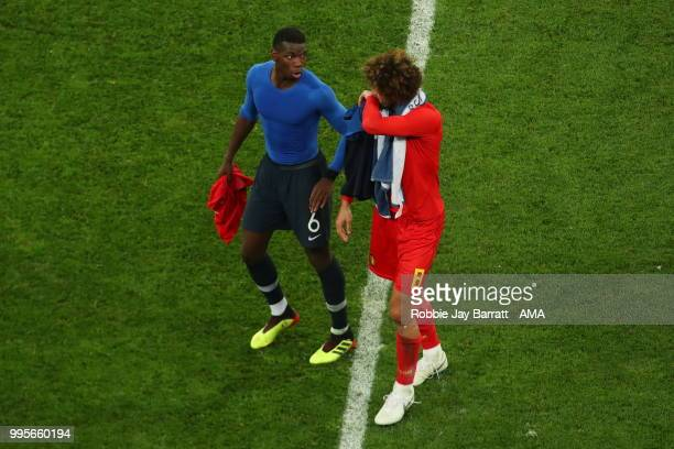 Manchester United teammates Paul Pogba of France and Marouane Fellaini of Belgium at full time during the 2018 FIFA World Cup Russia Semi Final match...
