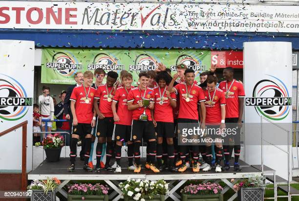 Manchester United u18's celebrate with the NI Super Challenge Cup after defeating Northern Ireland 10 at the Showgrounds on July 22 2017 in Coleraine...