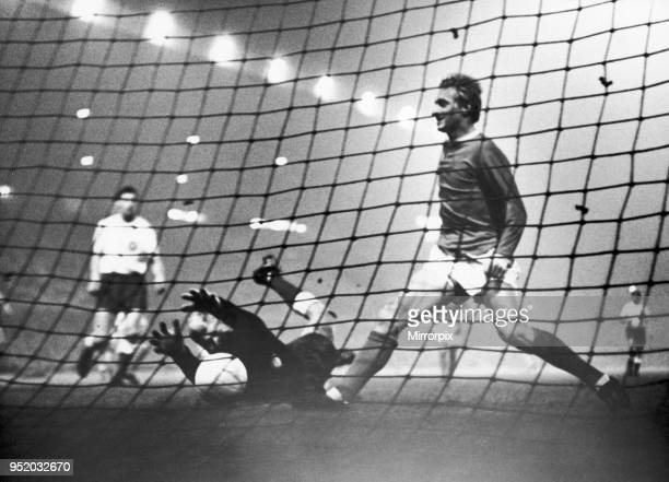 Manchester United v HJK Helsinki. HJK keeper claws for the ball but its to late as Denis Law make's sure the balls in the back of the net to give...