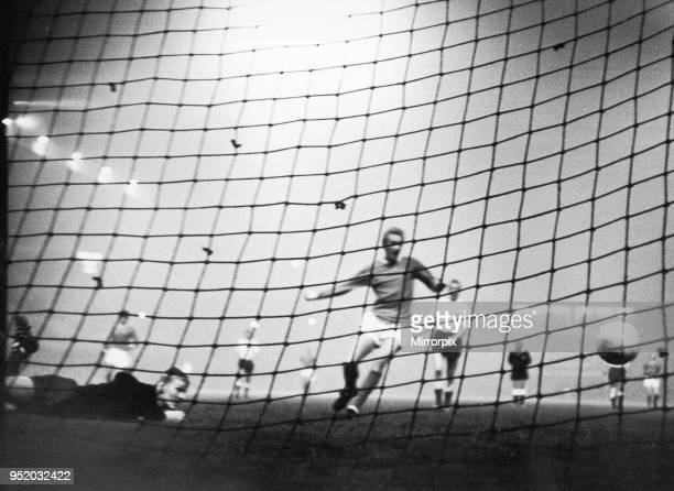 Manchester United v HJK Helsinki. HJK keeper dives and misses the ball as Denis Law sweeps in after the ball during Uniteds 6-0 victory over Helsinki...